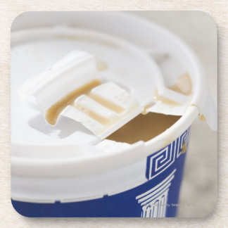 Close up of take out coffee drink coaster