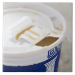 Close up of take out coffee large square tile