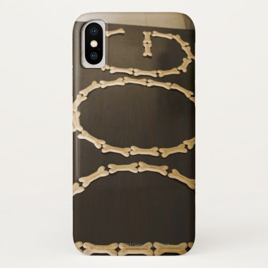 Close-up of text DOG made with dog biscuits on a Blackberry Case