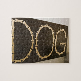 Close-up of text DOG made with dog biscuits on a Jigsaw Puzzle