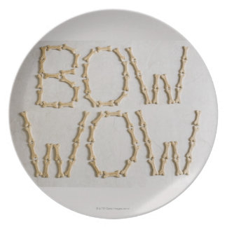 Close-up of texts BOW WOW made with dog biscuits Dinner Plate