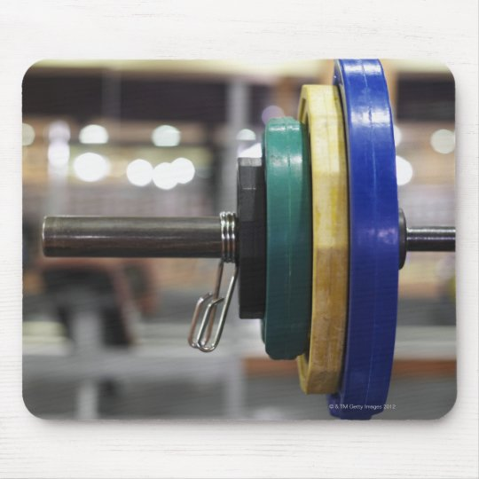 Close-up of the weights on a barbell mouse pad