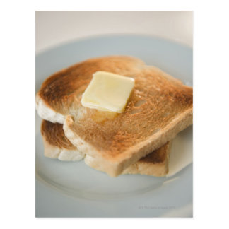 Close up of toasts with butter on plate postcard