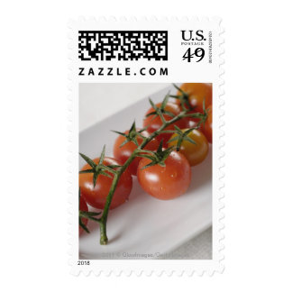 Close-up of tomatoes on a tray postage stamps