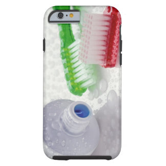 Close-up of toothpaste and toothbrushes covered tough iPhone 6 case
