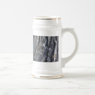Close-up of tree trunk's grey bark beer stein