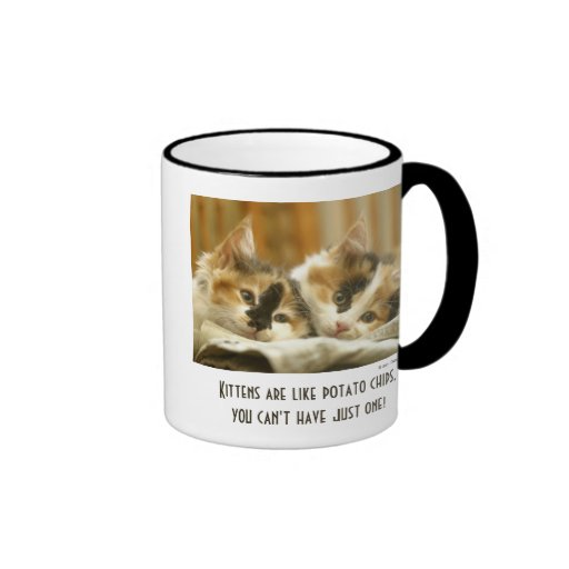 Close-up of two cats lying down ringer coffee mug