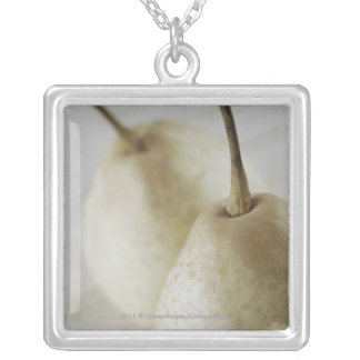 Close-up of two pears square pendant necklace