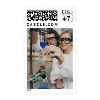 Close-up of Two University Students Adjusting Postage