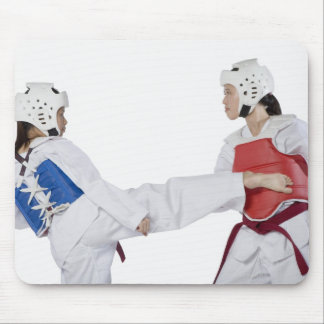 Close-up of two young women practicing mouse pad