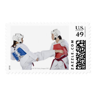 Close-up of two young women practicing postage stamp