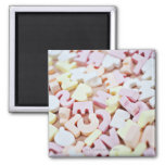Close up of vibrant candy alphabet 2 inch square magnet