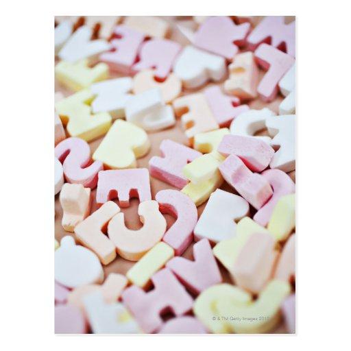 Close up of vibrant candy alphabet postcard