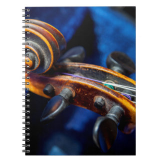 Close-Up Of Violin In Its Case Notebook