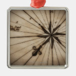 Close up of wind rose on antique map christmas ornaments