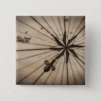 Close up of wind rose on antique map pinback button