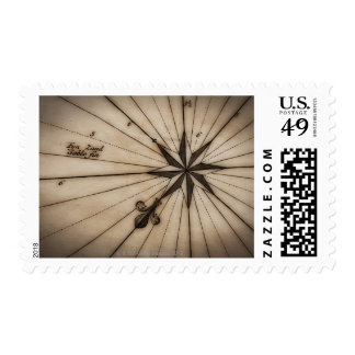 Close up of wind rose on antique map postage