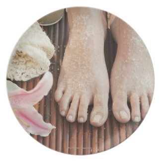Close-up of womans feet having spa treatment dinner plate