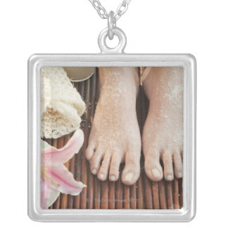 Close-up of womans feet having spa treatment square pendant necklace