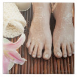 Close-up of womans feet having spa treatment large square tile