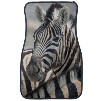 Close-up of zebra head between two other zebras car mat