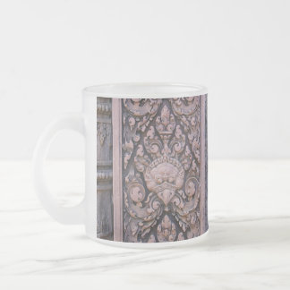 Close-up on an engraved red stone in Angkor 10 Oz Frosted Glass Coffee Mug