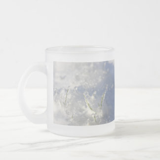 Close-up on green grass stems very iced frosted glass coffee mug