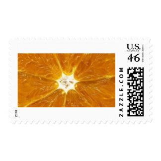 close up photo of an orange postage