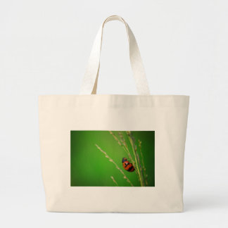 close up photo of ladybird with natural green back tote bags