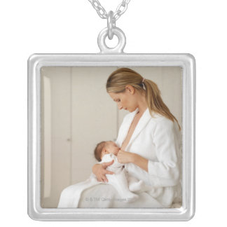 close up view of a baby (6-12 months) square pendant necklace