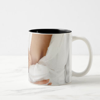 Close up view of a mother breastfeeding her baby Two-Tone coffee mug