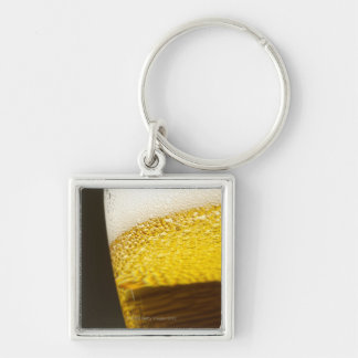 Close up view of beer, bubbles and foam in a keychain