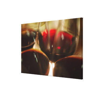 Close-up view of red wine glasses canvas print