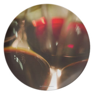 Close-up view of red wine glasses dinner plate