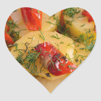 Close up view on a vegetarian dish of potatoes heart sticker