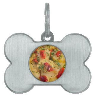 Close up view on a vegetarian dish of potatoes pet name tag