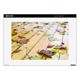 """Close-up view on a wet green and yellow leaves of 15"""" laptop decals"""
