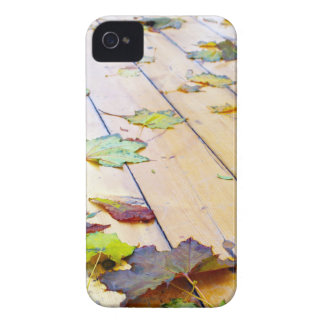 Close up view on a wet green and yellow leaves of Case-Mate iPhone 4 case
