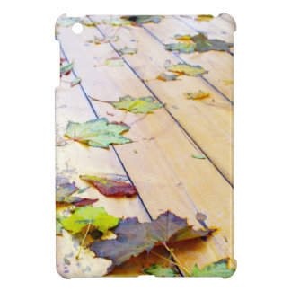 Close up view on a wet green and yellow leaves of iPad mini cover