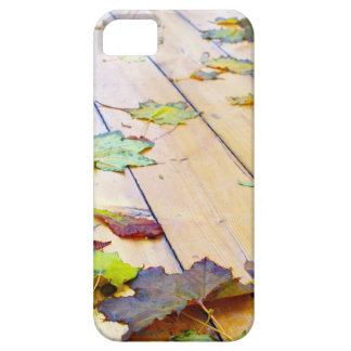 Close up view on a wet green and yellow leaves of iPhone SE/5/5s case