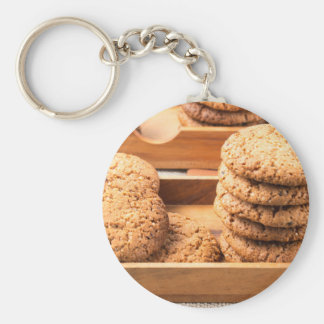 Close-up view on oat biscuits in wooden boxes keychain
