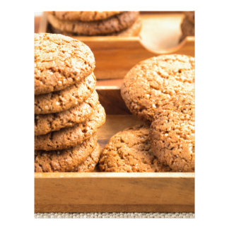 Close-up view on oat biscuits in wooden boxes letterhead