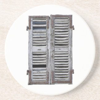 Closed window with old wood shutters drink coaster