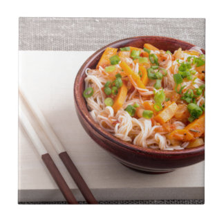 Closeup Asian dish of rice noodles and vegetable Ceramic Tile