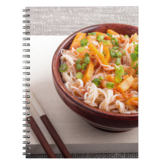 Closeup Asian dish of rice noodles and vegetable Notebook