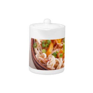 Closeup Asian dish of rice noodles and vegetable Teapot