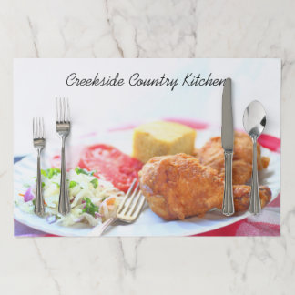 Closeup fried chicken dinner with copy space paper placemat