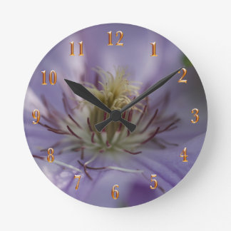 Closeup of a beautiful flower gold numbers round clock