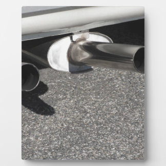 Closeup of a classic car exhaust pipe  Double pipe Plaque