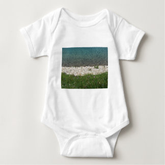 Closeup of a crystal clear alpine lake baby bodysuit
